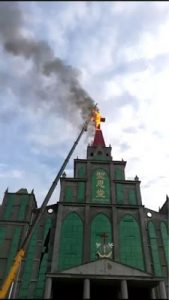 largest cross of the Holy Grace Church in Tanghe caught fire while being removed