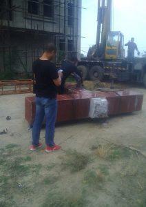 Men dismantling a cross