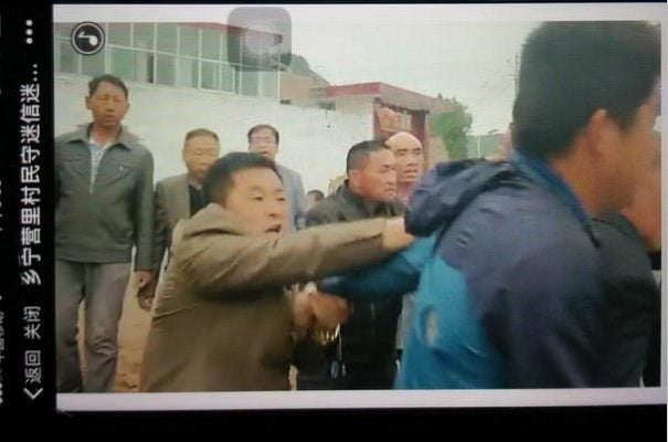 Villagers beat believers outside the church.
