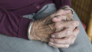 Elderly Christian Lady Under Police Surveillance