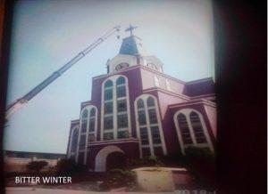 The cross of Bo'ai Church sawed