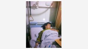 Mr. Zhou and his wife in the hospital