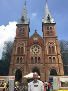 Massimo Introvigne in front of the Cathedral of Notre Dame, Saigon, Vietnam