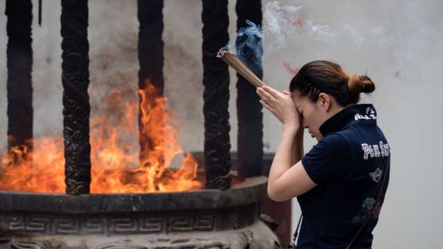 Incense burning in Shanghai. Posting a picture like this on the Internet will become illegal in China when the new draft becomes law.