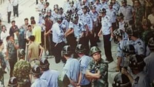 The local government sent in 300 police officers to threaten villagers into signing the agreement.