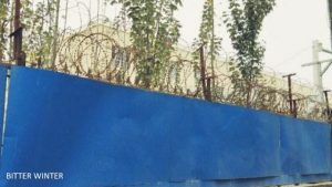 The fence surrounding the camp has been fitted with barbed wire and covered with blue steel shee