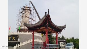 A crane is tearing down the statue 2