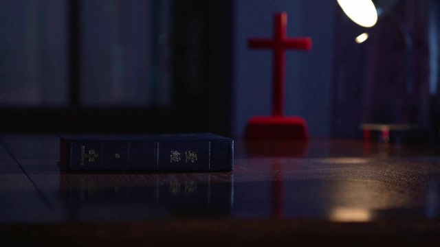 Bible and cross on the desk