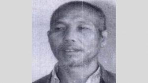 A police photograph of Ji Sanbao