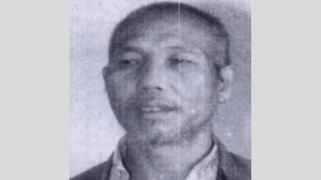 A police photograph of Ji Sanbao