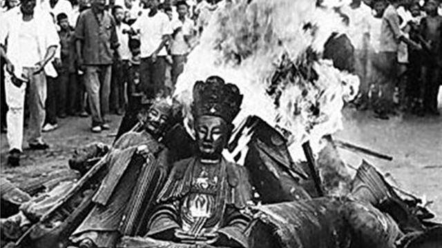 Buddhist statues burned
