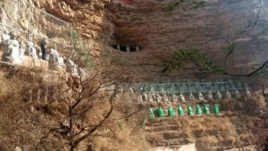 Some statues were covered with a green cloth.