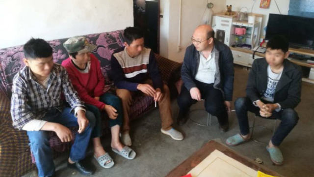 government official visits a family