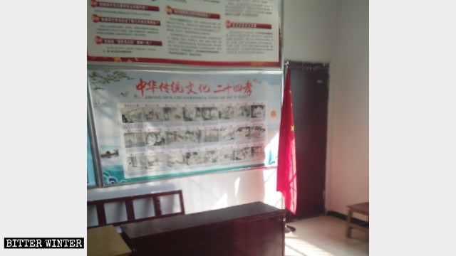 "A poster with pictures of the ""24 Filial Exemplars"" is on display at Oubeisha Church."