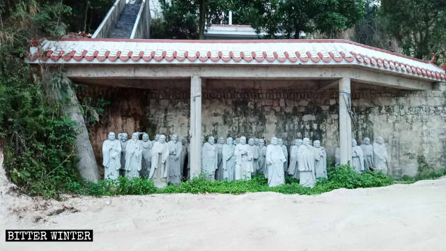 Arhat statues moved under the eaves