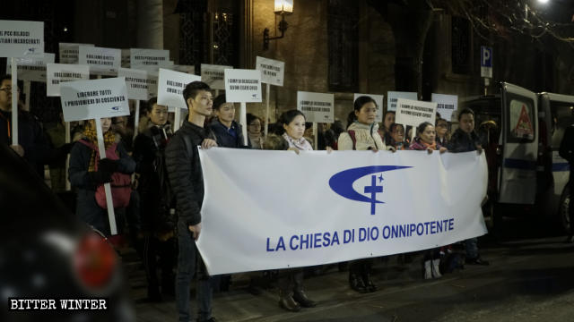 CAG believers during the Torchlight Procession for Peace in Rho, Milan