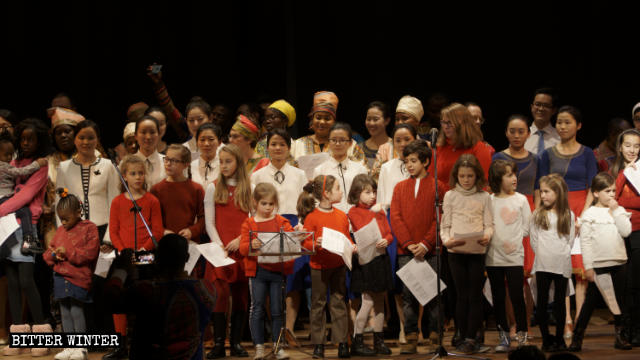 Choir with children and CAG believers during the Torchlight procession for Peace in Rho, Milan