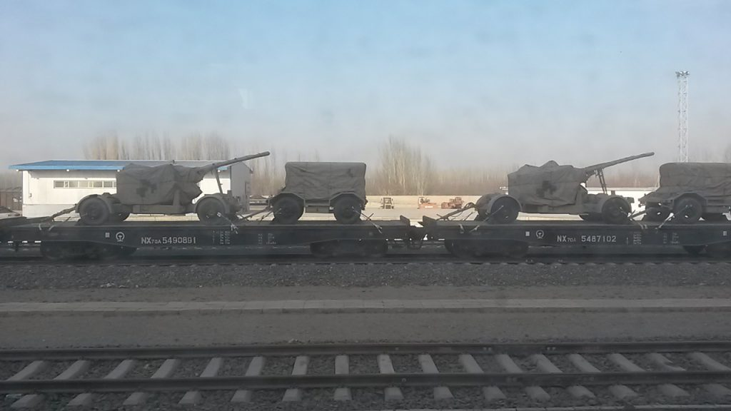 Field guns and ammunition trucks being moved by rail to Hotan for the build up of 'internal security' in the south of Xinjiang in November 2017.