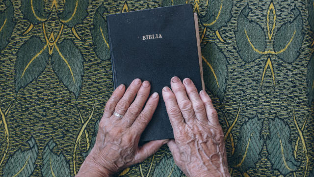 elderly man and the Bible