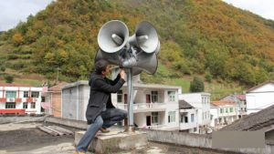A worker is installing loudspeakers in Zhenping county
