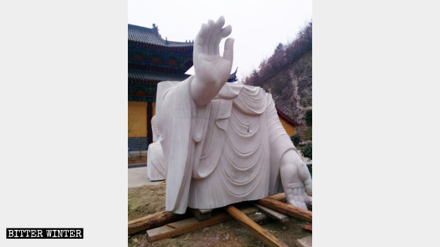 Guanyin statue's body removed.