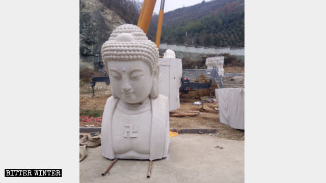Guanyin statue's head removed.