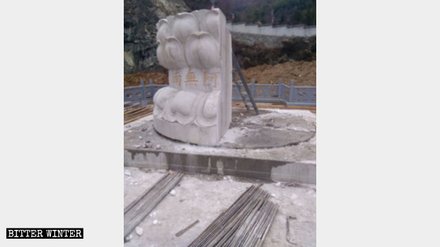 Guanyin statue completely demolished, leaving only a base.