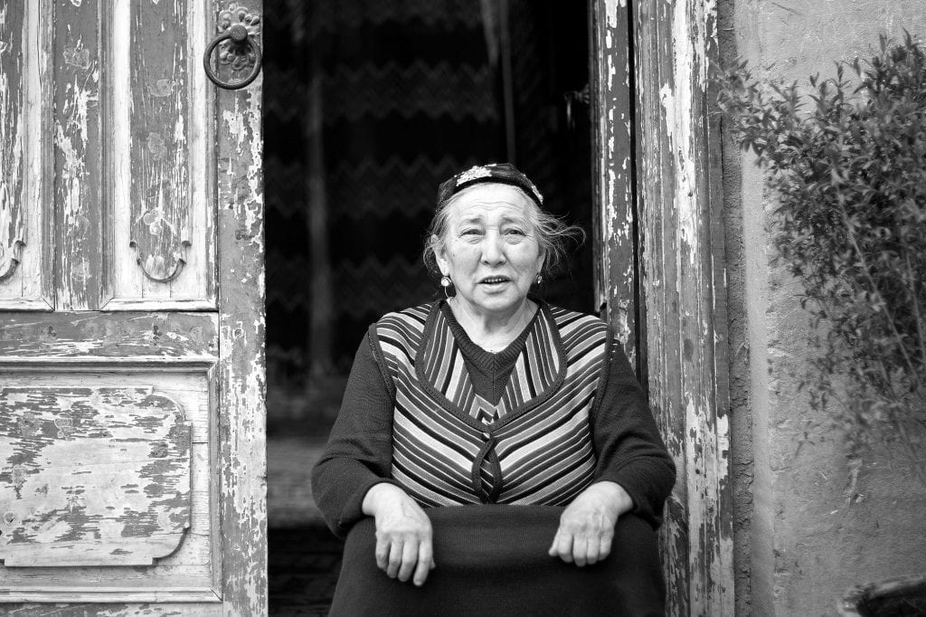 An Uyghur woman at her home's door in Kashgar.