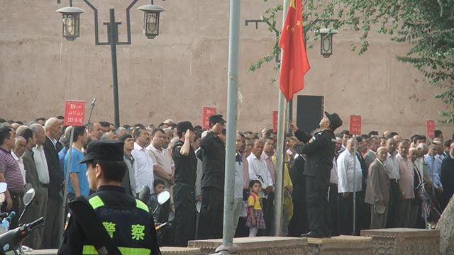 Uyghurs gather for the compulsory Monday morning political meeting