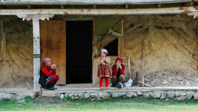 Women from Xinjiang live in a shabby house