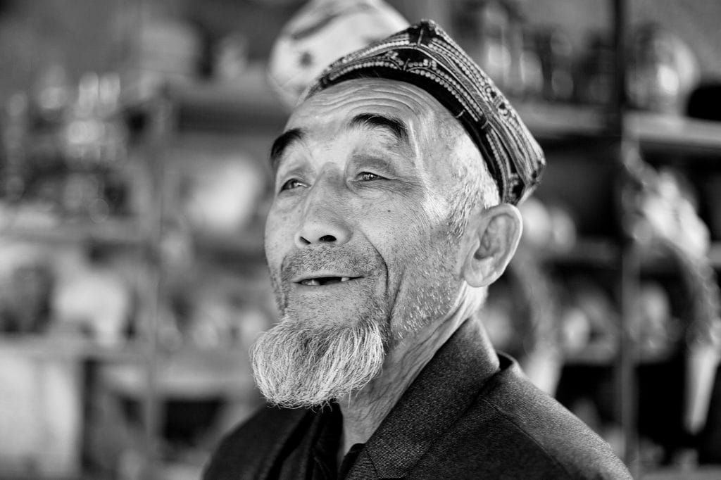 An Aksakal (an old and wise man) in his village booth near Turpan.