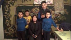 Attorney Aiman Umarova with orphan kazakh children