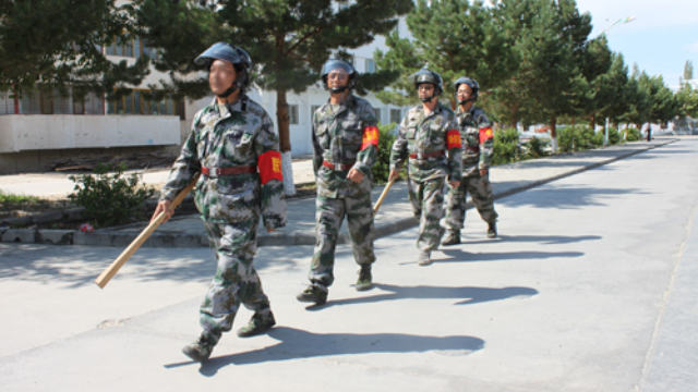 Militiamen are patrolling the streets in Xinjiang.