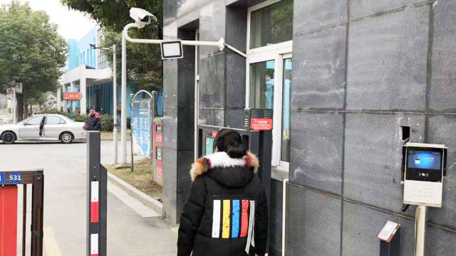Residents must scan their face before entering a community in Zhejiang's Yangzhou city.
