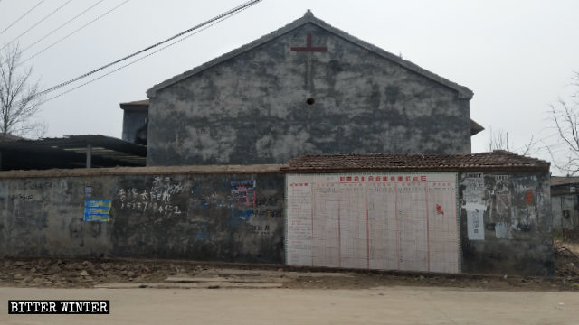 The cross on the exterior wall of Babu Church was destroyed.