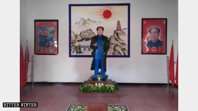 "A statue of Mao Zedong and portraits of CCP's four ""great men"" at Wanshou Palace in Jiujiang city."