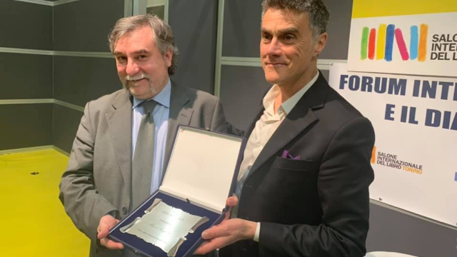 Marco Respinti receiving the award at the International Book Fair of Turin, Italy