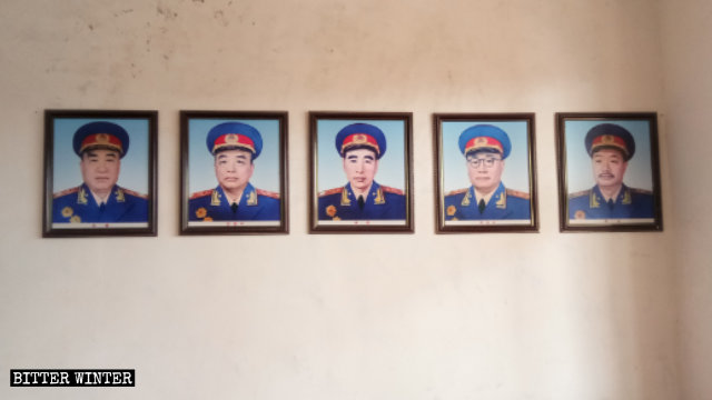 """Photos of the """"Ten Marshals of China"""" hang on both sides of the wall."""
