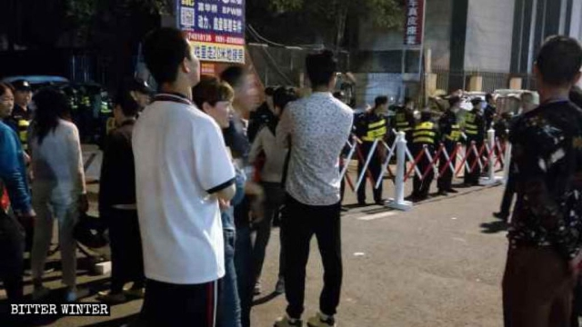 The police set up a checkpoint at the entrance and stopped believers outside the church