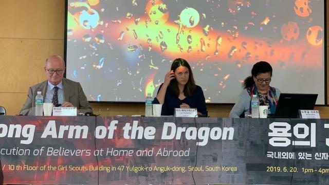 Massimo Introvigne, Lea Perekrests, and Nurgul Sawut at the Seoul event.