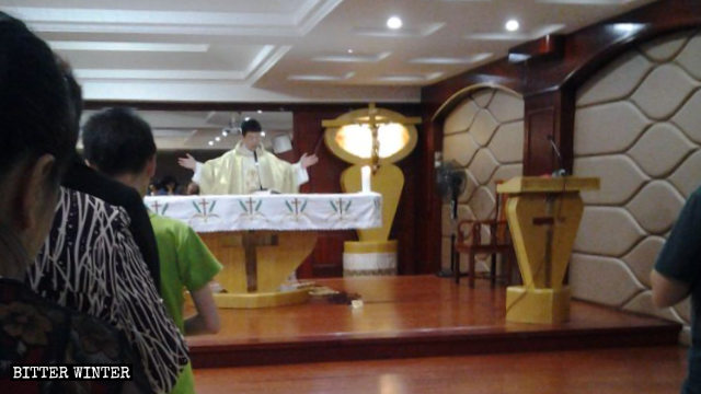 The priest was holding Mass when neighborhood committee personnel entered the church.