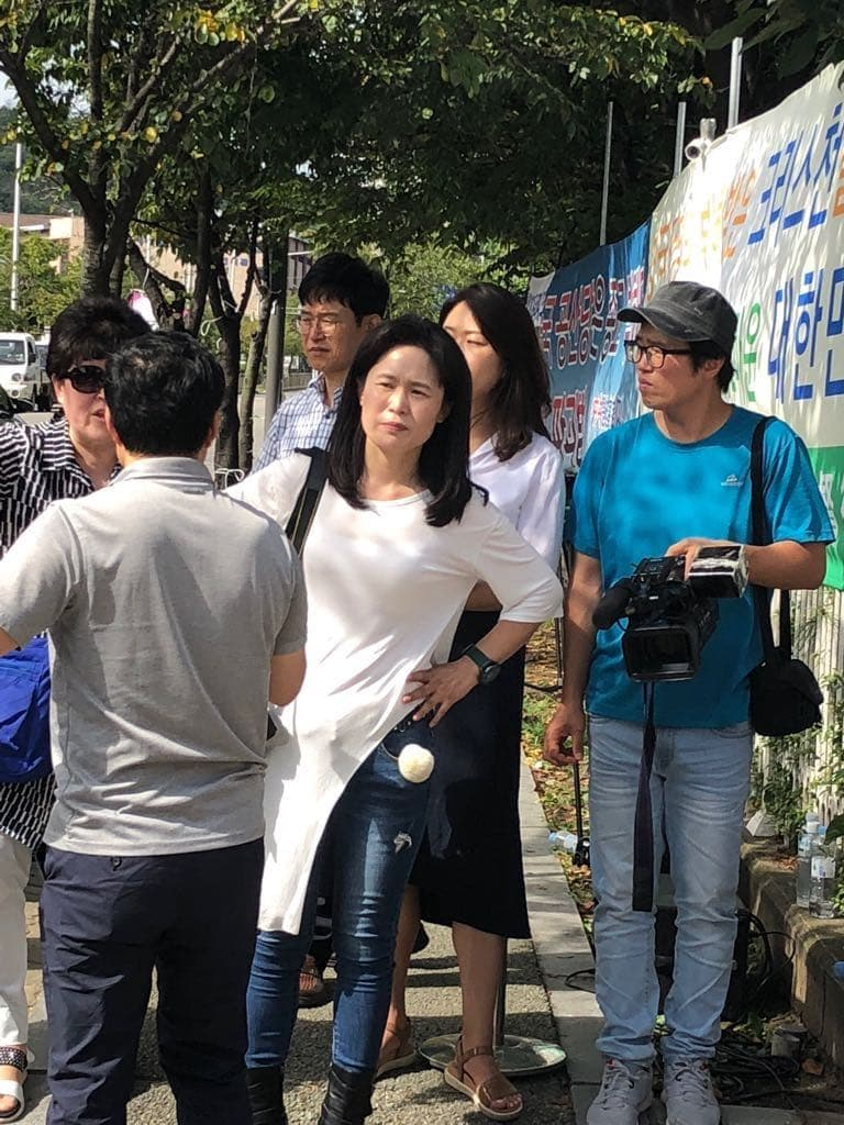 Ms. O during the false demonstrations of September 2018