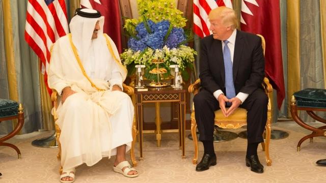 Qatar's ruler, Emir Tamim bin Hamad Al Thani, with U.S. President Donald Trump.