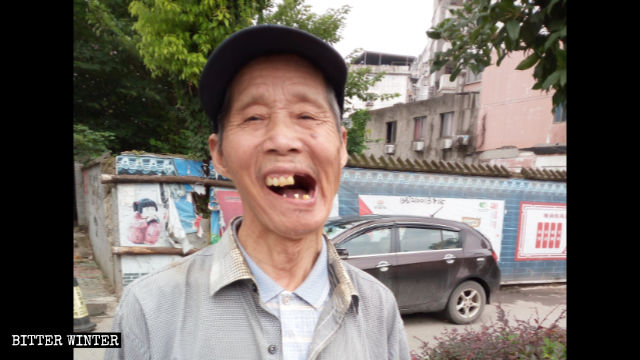Mr. Yan's teeth were knocked out during a beating by hired thugs.