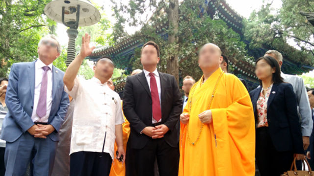 The abbot of a temple is receiving foreign visitors