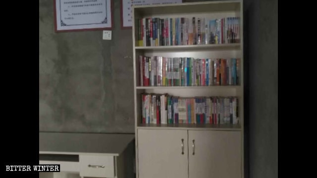 A Bookcase with propaganda materials has been placed in what used to be a Catholic church.