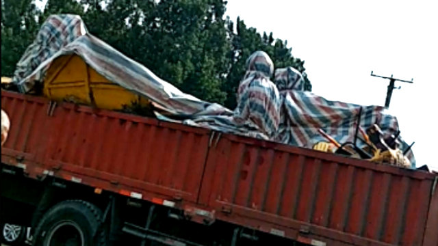 Dismantled Buddhist statues in Nama Temple were hauled away.