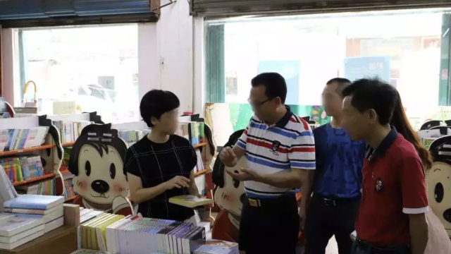 Government officials are inspecting publications in a bookstore in Guangdong Province.
