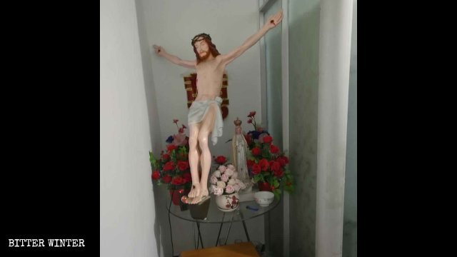 The crucifix has been moved from the main hall to a small room.
