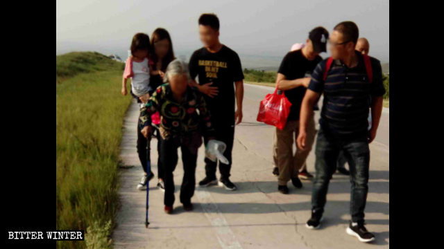 A white-haired older woman had to use a cane to get to the pilgrimage site on the mountain.